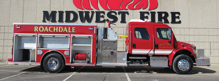 A pumper with a top-mount pump operator's panel and a four-door commercial chassis.