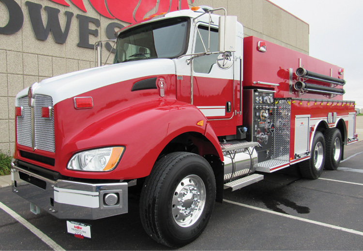 This two-door Kenworth tandem-chassis tanker-pumper has the forward portion of the tank notched over the pump module.