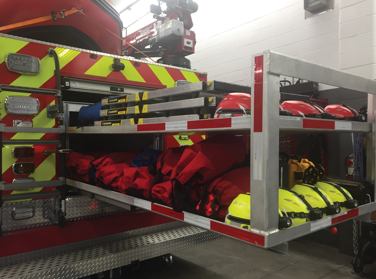 The rear compartment has a custom two-tier adjustable roll-out shelf that extends 90 percent and houses the bulk of the rope rescue equipment.