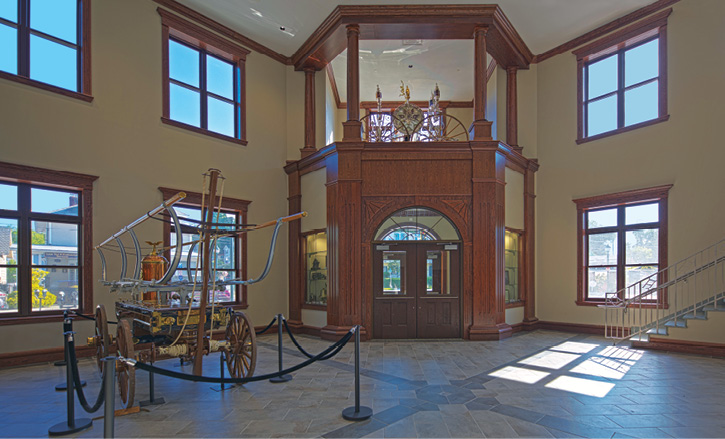 The lobby/fire museum area where the department's antique pumper is displayed.