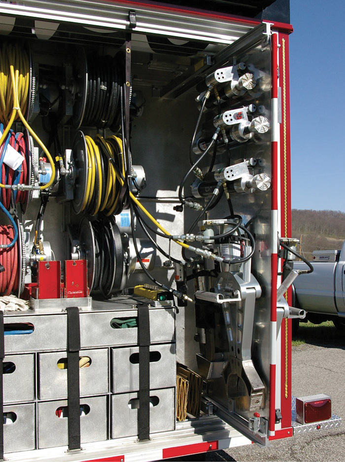 Another storage solution by Summit Fire Apparatus mounts hydraulic rescue tools on a slide-out tool board in the L5 compartment of a truck.