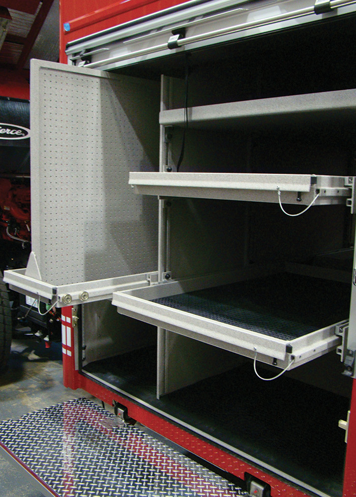 Pierce built this compartment with one sliding board, two sliding trays, and a fixed tray with a slide-out step underneath as a special request on a heavy rescue.
