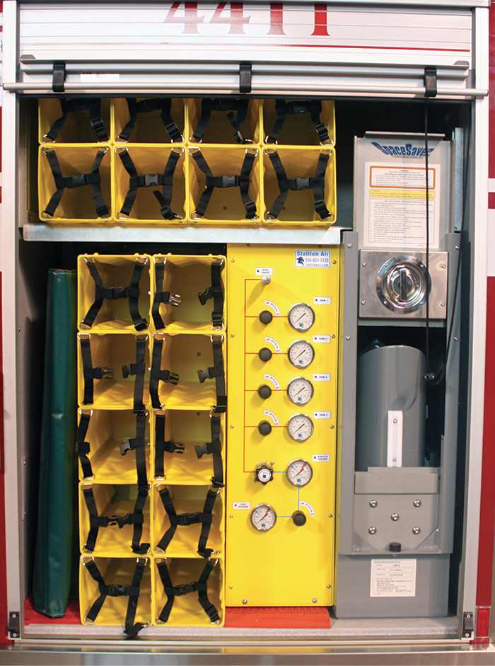 Ziamatic makes the PACSR Plastic Quik-Storage Rack and restraints, shown in this rescue truck fill station compartment.