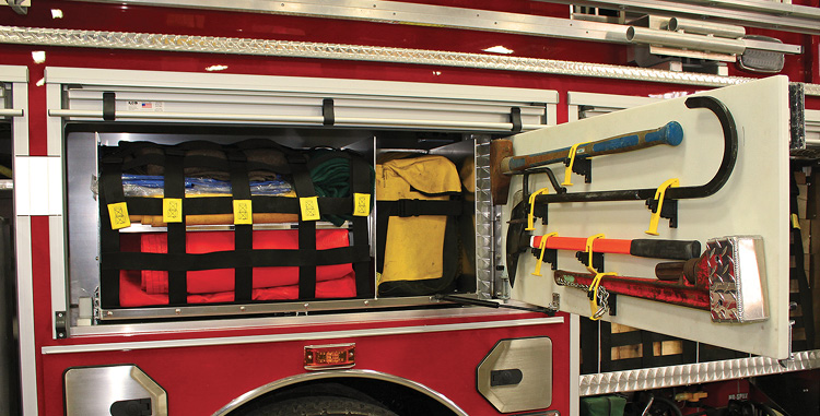 Fire and Marine makes a swing-out tool board that pulls a second board off the back wall of a compartment, as shown installed in this Richland Township (PA) Fire Department rescue truck.