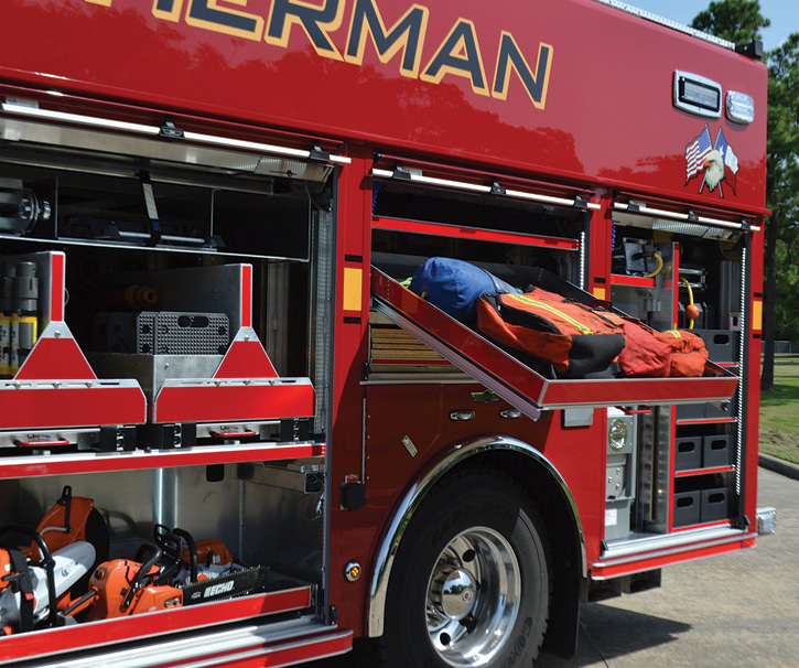 Compartments that are above chest height have slide-out, drop-down trays.
