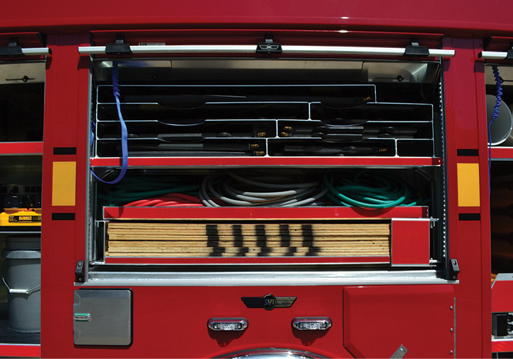 A compartment over the rear axle holds seven 5⁄8-inch thick and seven ½-inch-thick sheets of 4 × 8 plywood.