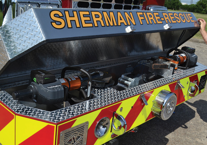 SVI built a full-width recessed tray in the extended front bumper to hold Sherman's Holmatro EVO 4 rescue tools, a 24-inch spreader, ram, ram block, cutter, spare batteries, charger, and 110-volt outlets for the charger.