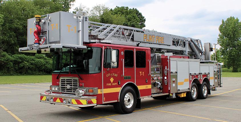 HME Ahrens-Fox—Flint (MI) Fire Department aerial platform quint. Spectr MFDxl cab and chassis; Cummins X12 500-hp engine; Hale Qmax 2,000-gpm pump ; 500-gallon polypropylene water tank; 104-foot aerial platform. Dealer: Matt Creech, Kodiak Emergency Vehicles, Lansing, MI.