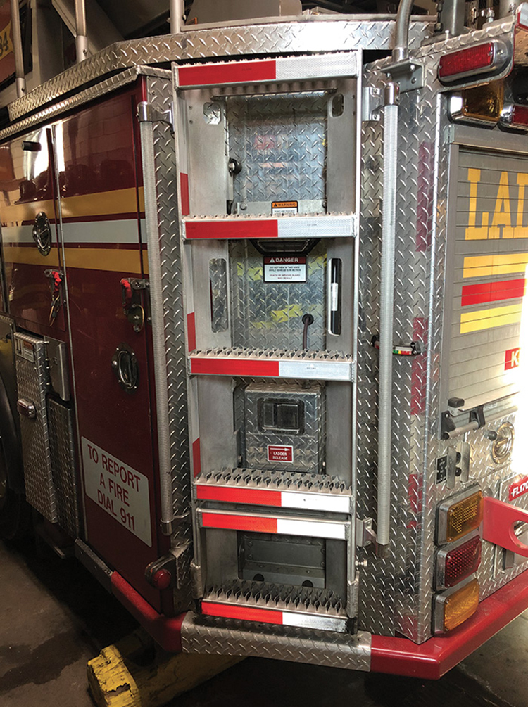 The design of the FDNY's Ferrara rear-mount apparatus required it to be of an angular design, allowing an easier swing out of quarters and less damage to the access ladder.