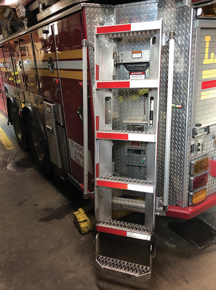 The FDNY's Ferrara access ladder in the down position with lower step deployed.