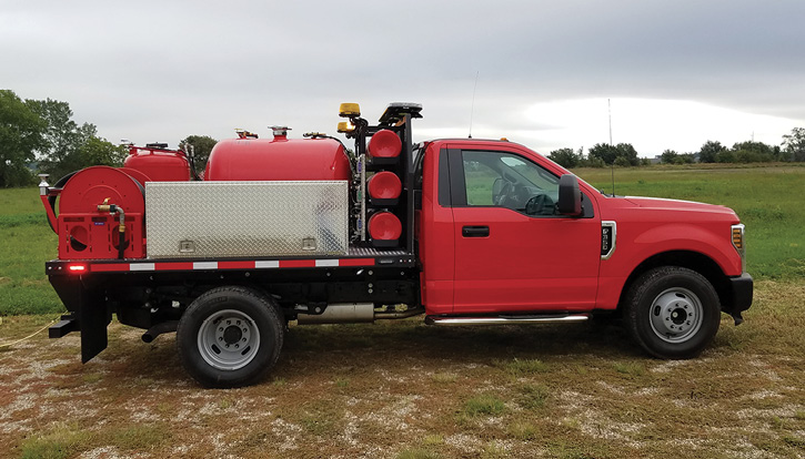 Unruh Fire built this small ARFF rig for the Liberal (KS) Fire Department, which covers a local airport, on a Ford F-350 chassis and nine-foot custom-built flatbed carrying 500 pounds of dry chemical, a TRI-MAX TM5200 CAFS unit with 200 gallons of premix, and a twin-agent hose reel. (Photos 1-3 courtesy of Unruh Fire.)