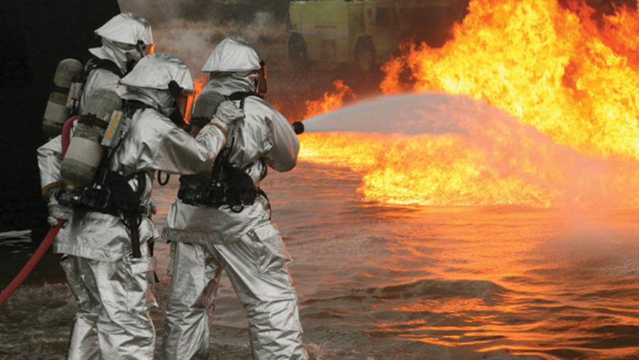 Firefighters outfitted in INNOTEX proximity gear tackle a flammable liquid fire.