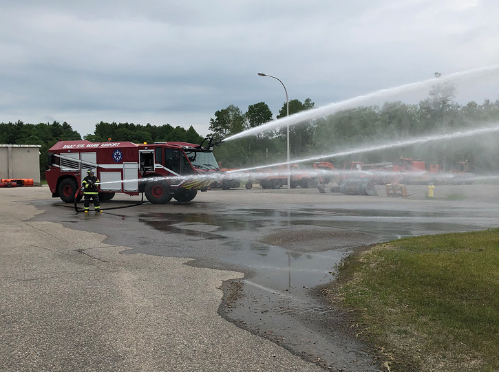 Sault Ste. Marie Airport firefighters operate all of the TITAN's extinguishing systems at once during a training exercise. (Photo courtesy of the Sault Ste. Marie Airport.)
