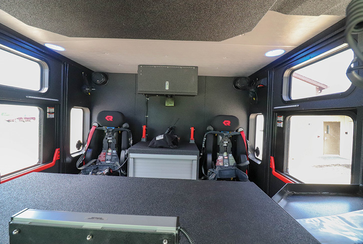 The crew cab on the rescue-pumper has two outboard forward-facing H.O. Bostrom seats with a cabinet between them. Behind the driver's and officer's seats are two gear compartments, accessible from the exterior.