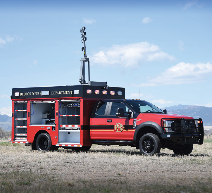 The Bedford (TX) Fire Department air and light unit showing the officer's side with the Command Light elevated.