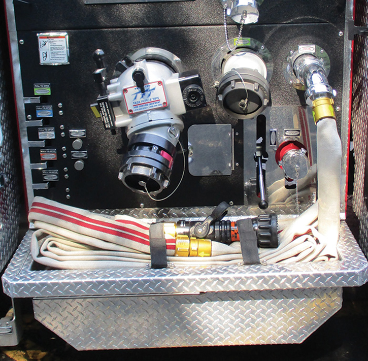 """This 2019 Pierce pumper has a designated water and foam-capable 2½-inch discharge supplying a preconnect in a running board trough. Although labeled """"Trash Line,"""" it has 150 feet of 1¾-inch hose and a Task Force Tips nozzle and can be used on much more than a grass fire!"""