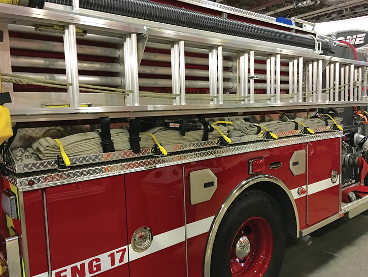 These rigs have bundled hose packs mounted on tops of low side running board compartments. Years ago, fire departments would load hose in the same location, strap or bungee cord it down, and preconnect it to a side discharge—an inexpensive preconnect. There's no reason why it can't be done today even with some of the hose packs. They can serve a dual purpose.