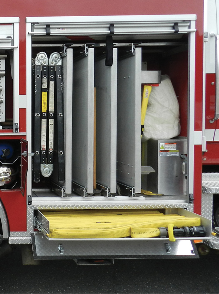 Preconnects on slide-out trays mounted below the running board compartments. It's not too often firefighters have to bend down to load preconnects.