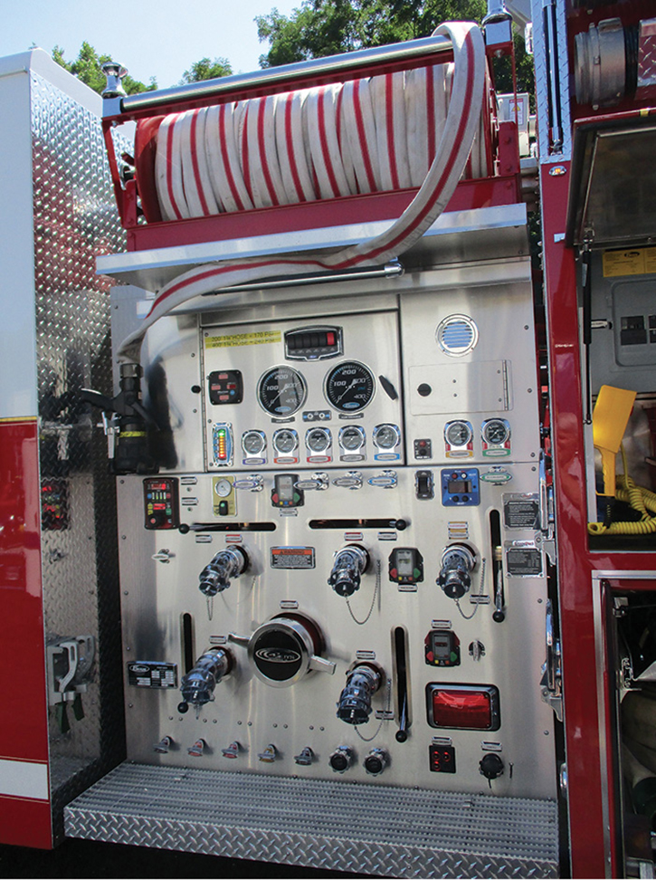 """This 4 Guys pumper does not have a trash line or preconnected crosslays. """"Dry"""" electric rewind reels on each side carry 400 feet of 1¾-inch hose. The first length off is 100 feet long and the balance are 50 feet. The department """"pulls and breaks"""" the number of lengths needed and connects to a side discharge. They're easy to reload."""