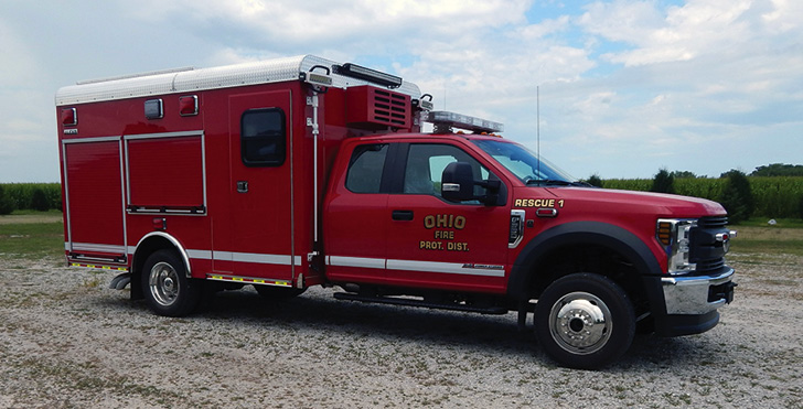 Alexis—Ohio (IL) Fire Protection District, Response One squad with 12-foot walk-in body. Ford F-550 XL 4×4 Super Cab DRW cab and chassis; Ford Power Stroke 6.7L 330-hp diesel engine; heavy-duty aluminum body; walk-in EMS in forward area with right side walk-in door and windows; two drop-down squad bench seats; interior squad area; two upper storage compartments. Dealer: Jon Pittard, Alexis Fire Equipment, Alexis, IL.