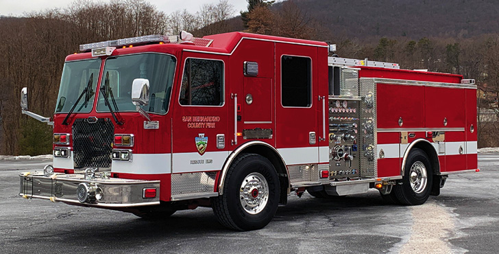 """KME—San Bernardino County (CA) Fire Department rescue-pumper. KME Severe Service cab and chassis; Cummins X12 500-hp engine; Hale Qmax 1,500-gpm pump; UPF Poly 500-gallon water tank; 30-gallon foam cell; FoamPro 2001 single-agent foam system; external EMS compartment with hinged doors and internal access; Vista interior; Zico """"single-arm"""" hydraulic ladder rack. Dealer: Brandon Gomez, REV Fire Group, Jurupa Valley, CA."""