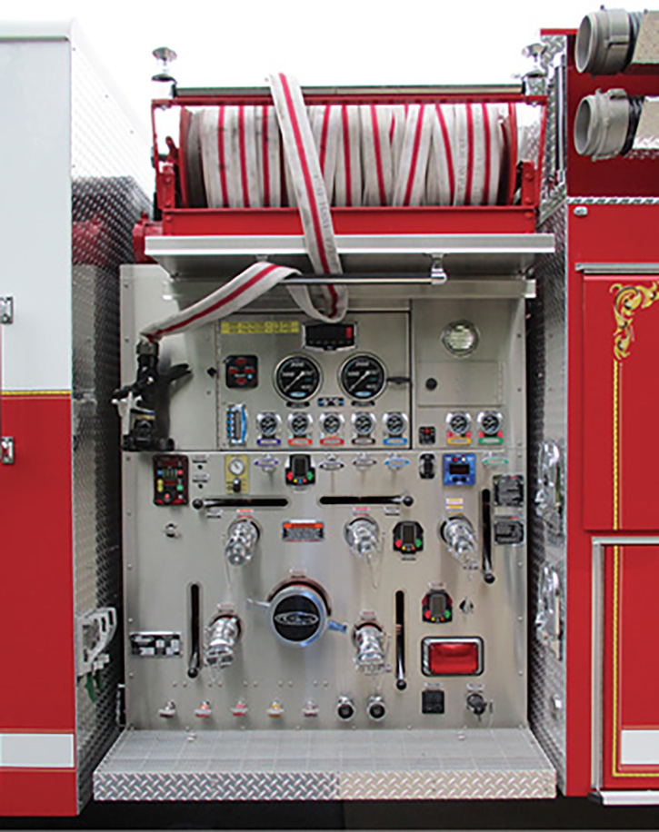 """The pump operator's panel controls are not all """"squished"""" together. The hose reels have been extended outward above the pump panels so they are almost level with the body sides. This allows the light tower to nest between them (photo 6). It is also noticeable in photo 1."""