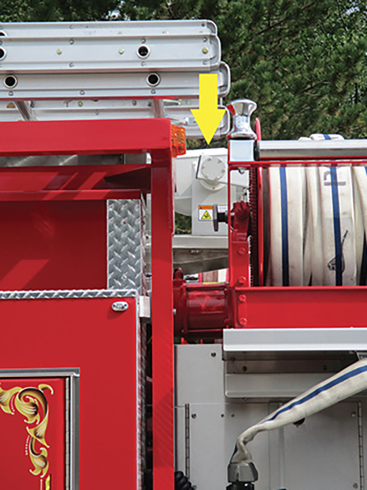 Just visible behind the hose reel is the light tower in its nested position.