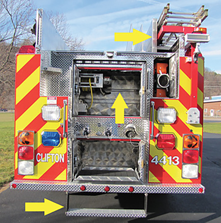 """A rear view of the 2010 engine. The upper arrow shows the right-hand hosebed side sheet was moved inward, enabling the ladders to rest lower. The middle arrow shows the lower of two full-width unistruts allowing reel adjustment or adding a reel in the future. The lower arrow shows the low """"flexible"""" auxiliary step. (Photo courtesy of Frank Riccobono.)"""