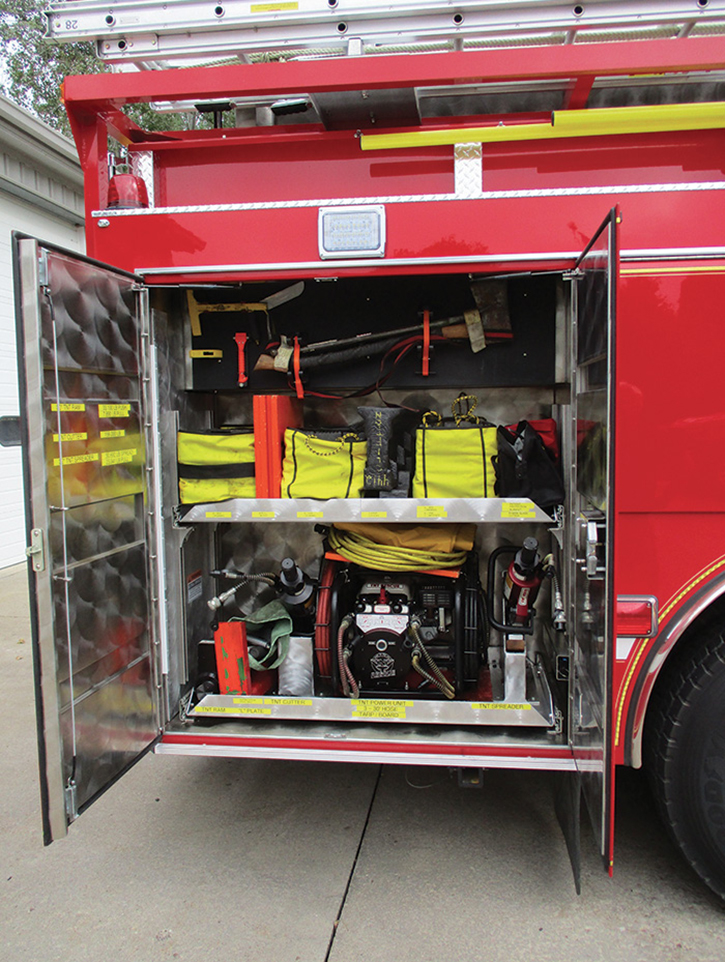 The compartment on the right side behind the rear wheels holds auto extrication equipment.