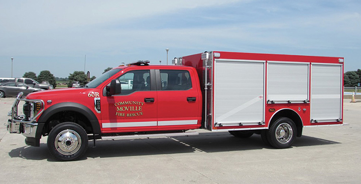 Danko—Moville (IA) Fire & Rescue 12.8-foot walk-around rescue. Ford F-550 Crew Cab and chassis; 6.8L 3 valve SOHC EFI 288-hp engine; Fab Fours black steel bumper replacement; ROM roll-up compartment doors; Whelen LED lighting. Dealer: Hayden Boeke, Danko Emergency Equipment, Snyder, NE.