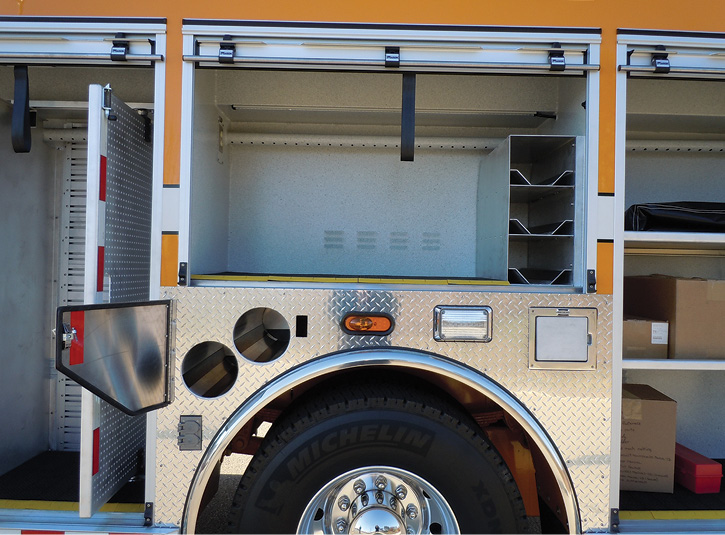 """In an effort to get more water on a pumper, Marion Body Works designs a water tank that comes up into a """"T"""" behind rollup door headers on 27-inch-deep compartments. (Photo courtesy of Marion Body Works.)"""