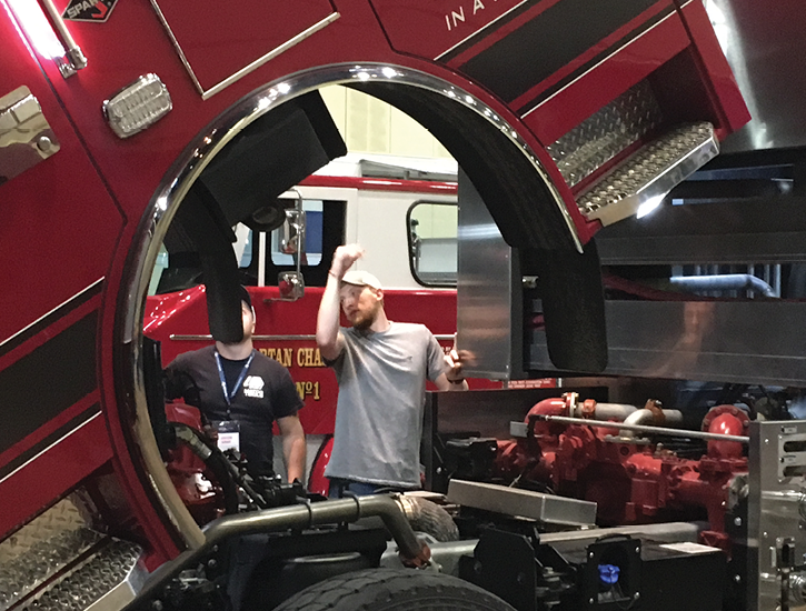 Attendees at Spartan's 25th annual Fire Truck Training Conference look at one of the many trucks on hand at the event, in this case Spartan's IPS-NXT.