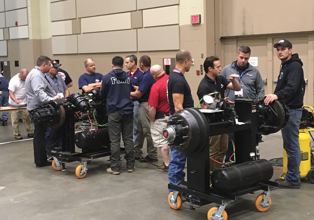 Attendees get hands-on training on chassis components.