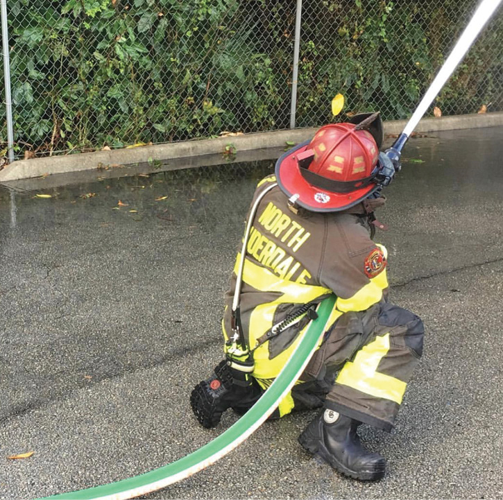 A firefighter wears Black Diamond X2 leather structural firefighting boots during a hose training exercise. (Photo 10 courtesy of Carhartt Footwear/Black Diamond Group.)