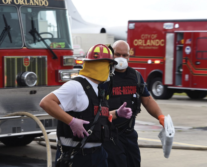 Orlando (FL) Fire Department firefighters deploy wearing body armor during a training session.