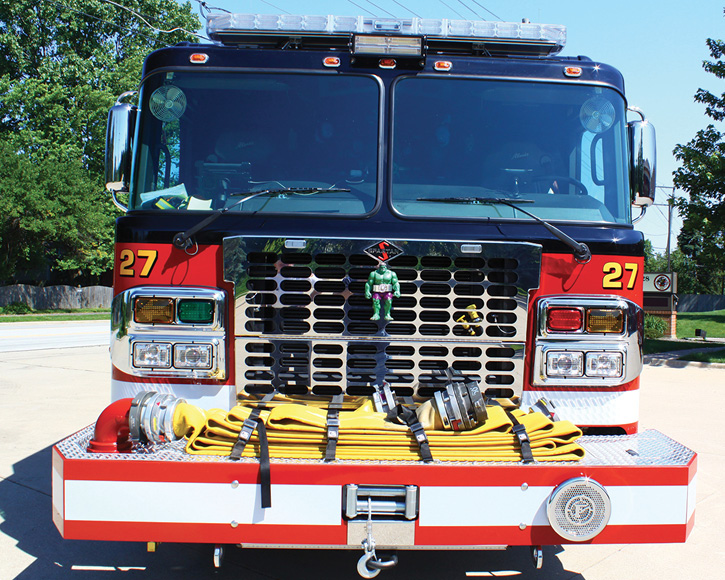 The front of Squad 27 with 75 feet of five-inch supply line in a front tray and the rig's 12,000-pound winch.