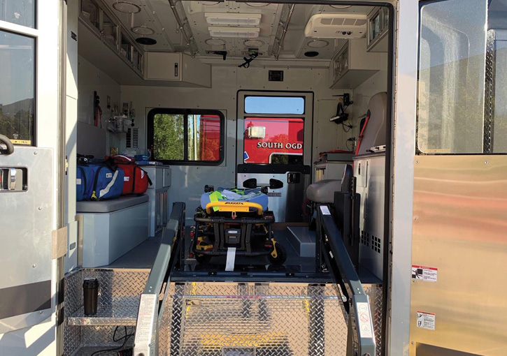 EMS transport area of pumper with extended body behind cab.