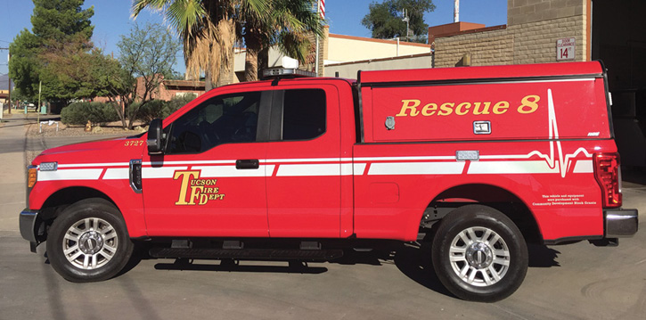 One of Tucson's Alpha Trucks, a pickup truck staffed by an EMT and a paramedic designed to take the heavy EMS work load off of suppression companies. These rigs have short wheelbases with two-door extended cabs and short beds with caps. [Photo courtesy of the Tucson (AZ) Fire Department.]