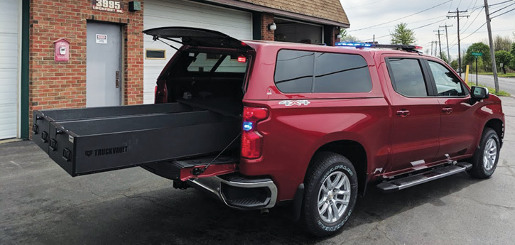 """Two basic slide-out storage units mounted in the bed of a four-door pickup with a cap. One could be """"environmentally sealed"""" to carry turnout gear, if applicable, while the other could be used for medical equipment. Some slide-out units can be very elaborate. (Photo courtesy of Empire Emergency Equipment.)"""