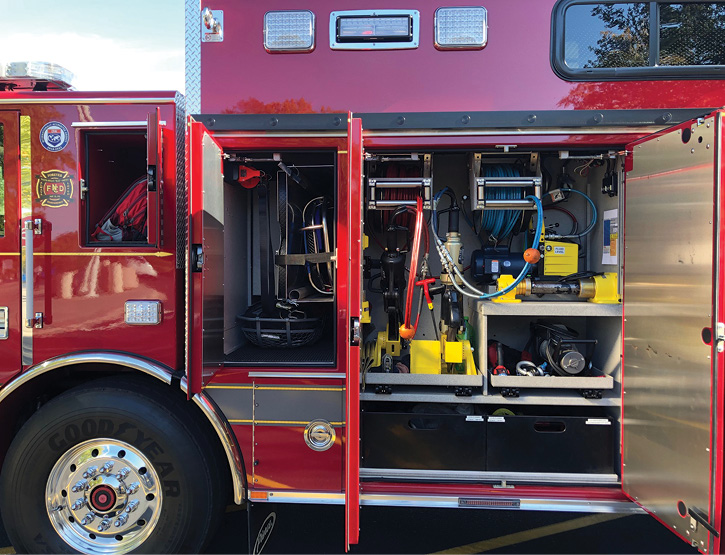 Both the D5 and P5 compartments hold two hydraulic hose reels with 100-feet of dual hose, along with Genesis spreaders, cutters, rams, and a combi tool.