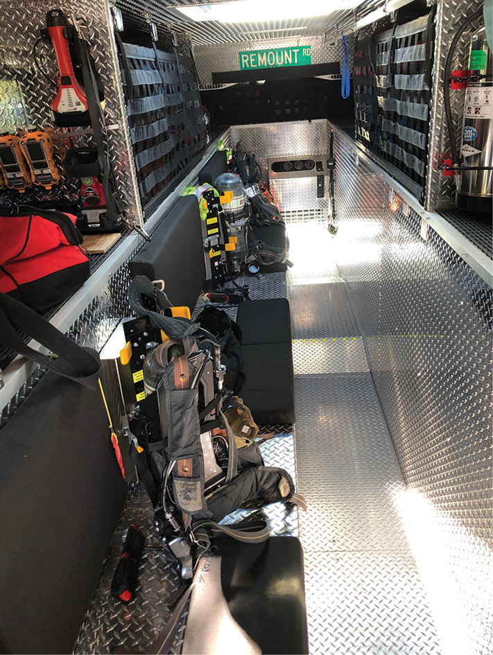 The interior of the walk-in section of the technical rescue seats five self-contained-breathing-apparatus-outfitted firefighters.