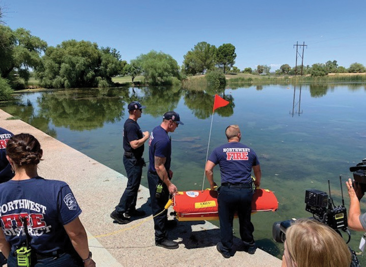 Northwest firefighters prepare to launch EMILY, a water rescue drone, during a training exercise.