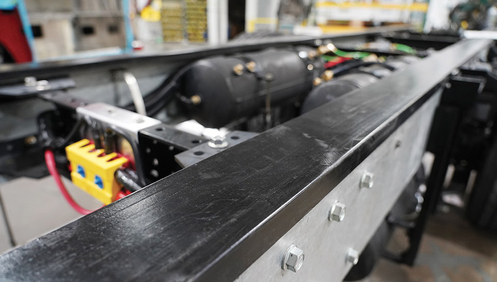 SVI Trucks isolates the steel chassis frame from aluminum bodies and subframes using 3⁄8-inch-thick UHMW plastic extrusions.