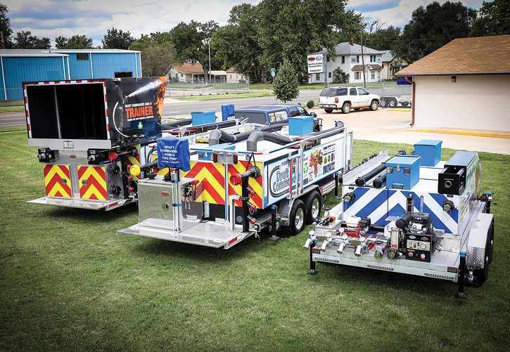 This photo shows the Draft Commander family of three units designed by Weis Fire and Safety to test fire pumps and fire appliances and train firefighters and fire pump engineers. Left to right are the Draft Commander 3000® Trainer, Draft Commander 3000®, and Draft Commander Mobile Appliance Tester.