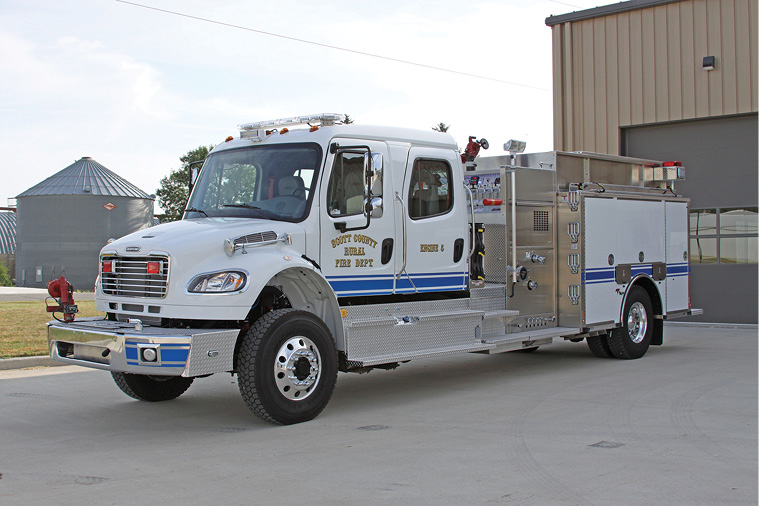 Weis Fire and Safety delivered this Toyne 1,250-gpm 1,250-gallon pumper-tanker to the Scott City (KS) Rural Fire Department on a four-door Freightliner. It features high left- and low right-side compartments, top-mount pump controls, a booster reel in the rear step compartment, an 8-kW hydraulic generator, and an extended front bumper with a monitor and a discharge for a preconnect. (Photo courtesy of Toyne.)
