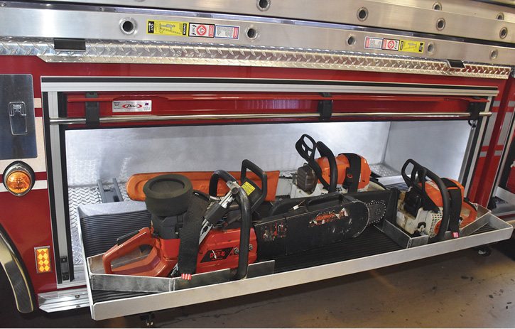 The rig has two saw compartments. One carries three chain saws.