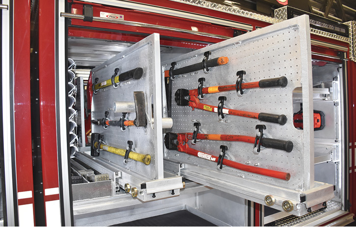 Forcible entry tools and hand tools on slide-out boards.