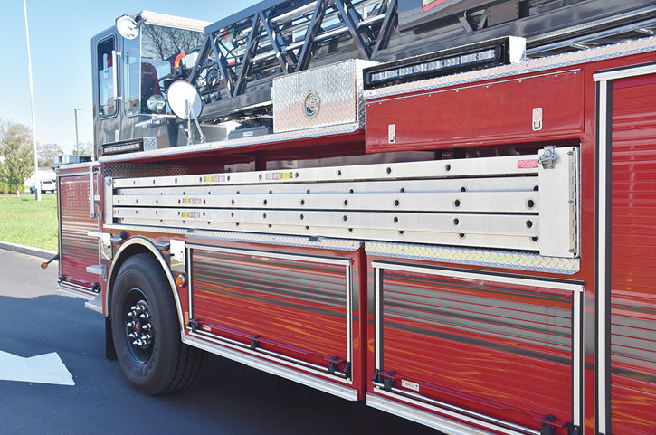 The rig's ground ladders mounted on the exterior.