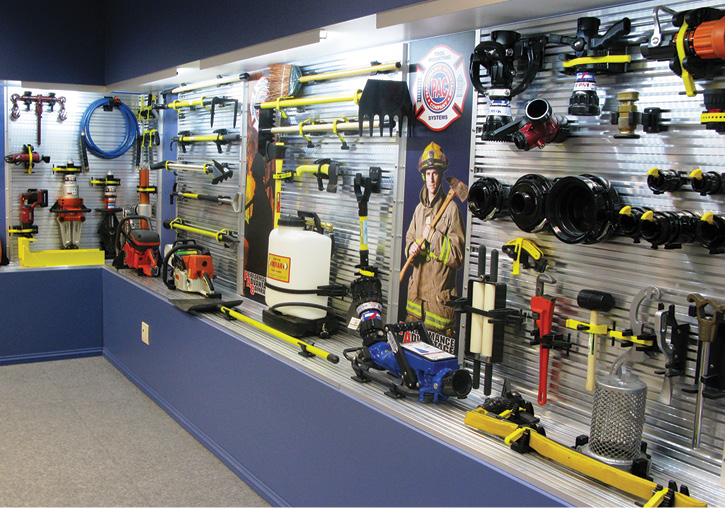Performance Advantage Company makes a wide array of tool mounting fixtures to hold just about any piece of firefighting equipment and appliance in apparatus. The fixtures are bolted to proprietary extruded aluminum mounting panels. The company exhibits its products in a showroom at its headquarters.
