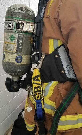 The JackStrap is designed to clip into the brackets on the side of the SCBA.